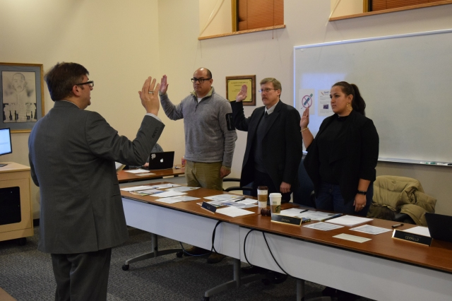One new and two existing Commissioners being sworn in by the City Clerk.