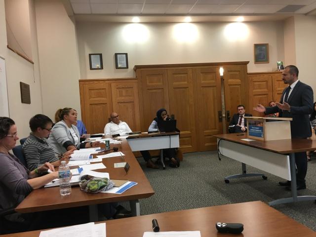 Intake Investigator Gabriel Ramirez discusses cases with Commissioners.